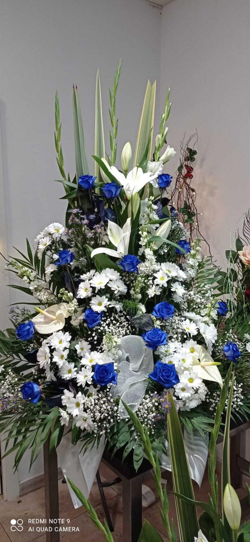 centro-de-flor-azul-cielo.precios....100E....130